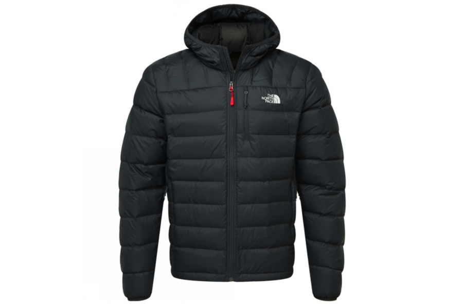 A black puffer jacket by North Face with a hood