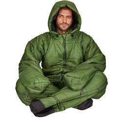 A green sleeping bag suit, being worn by a man who is sat with his legs crossed, he has the hood up.