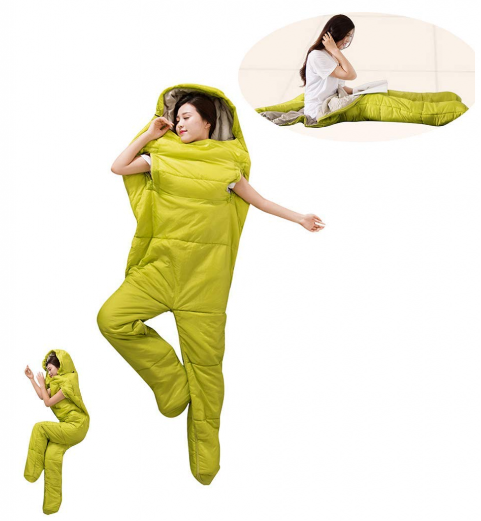 A lady lying down wearing a sleeping bag suit, the suit has legs and spaces for her arms.