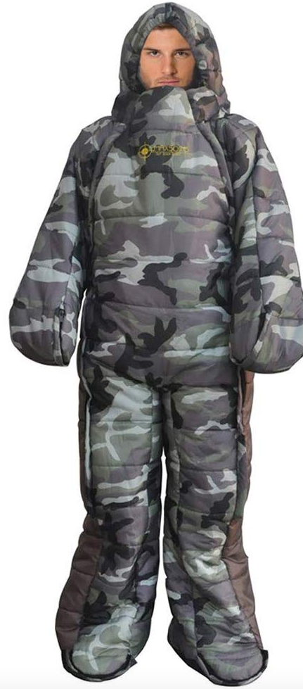 A camouflaged, grey and black  sleeping bag with arms and legs, being worn by a man.