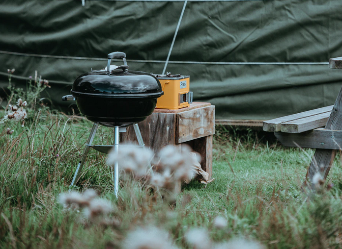 A barbecue outside a tent