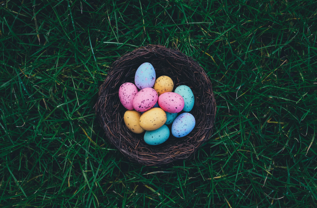 Coloured easter eggs in a brown basket