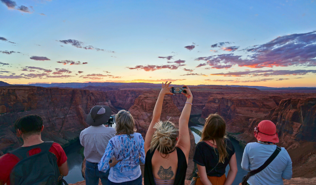 A group of people stood in the grand canyon