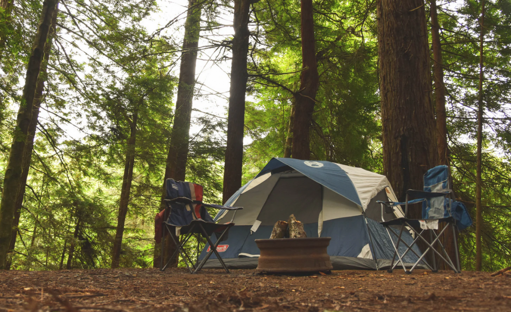 A tent with two camping chairs