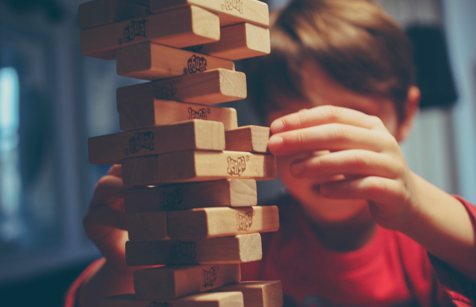 A young boy playing jenga