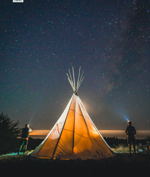 A teepee tent at night time