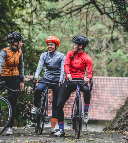Three women in cycling gear on bikes