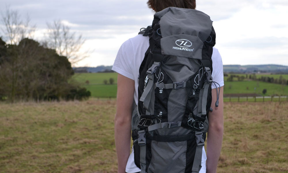 Young person with a rucksack on his back